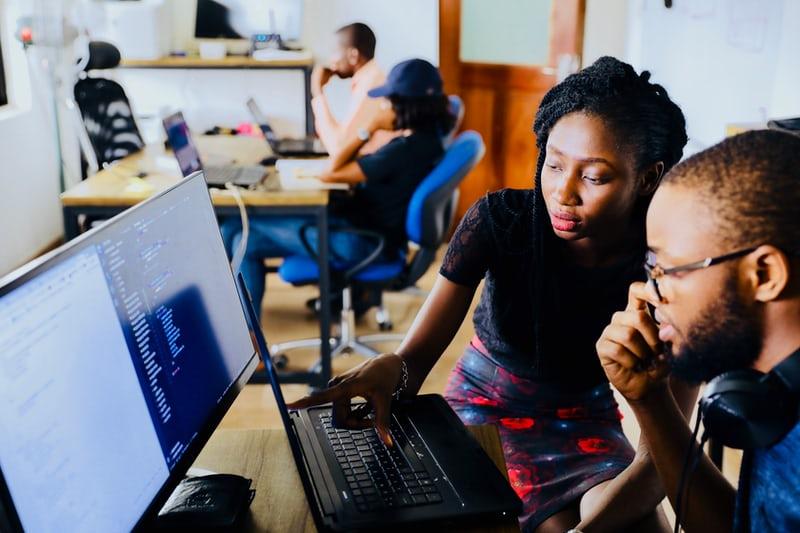 Teacher helping a student in an educational nonprofit organization